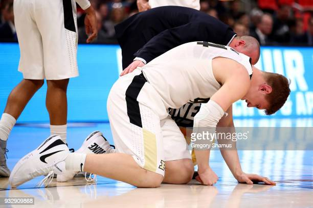 Isaac Haas of the Purdue Boilermakers reacts after falling to the court on a foul by Cal State Fullerton Titans during the second half of the game in...