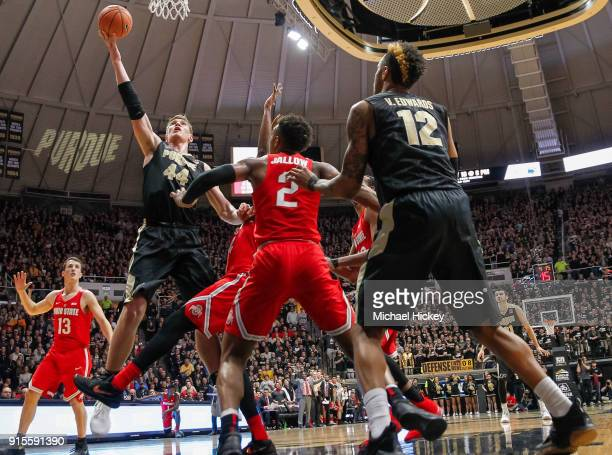 Isaac Haas of the Purdue Boilermakers shoots the ball against Andre Wesson of the Ohio State Buckeyes at Mackey Arena on February 7 2018 in West...