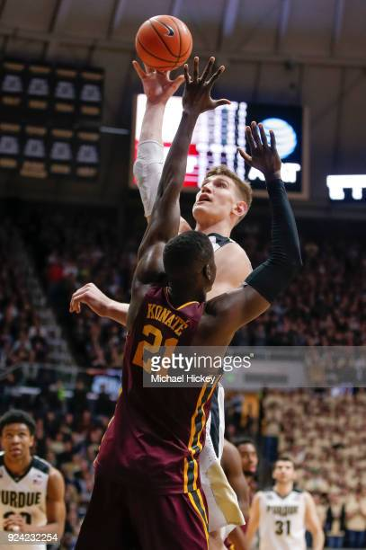 Isaac Haas of the Purdue Boilermakers shoots the ball against Bakary Konate of the Minnesota Golden Gophers at Mackey Arena on February 25 2018 in...