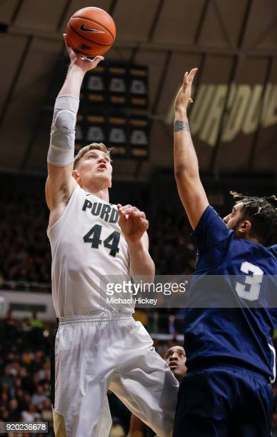 Isaac Haas of the Purdue Boilermakers shoots the ball over Satchel Pierce of the Penn State Nittany Lions at Mackey Arena on February 18 2018 in West...