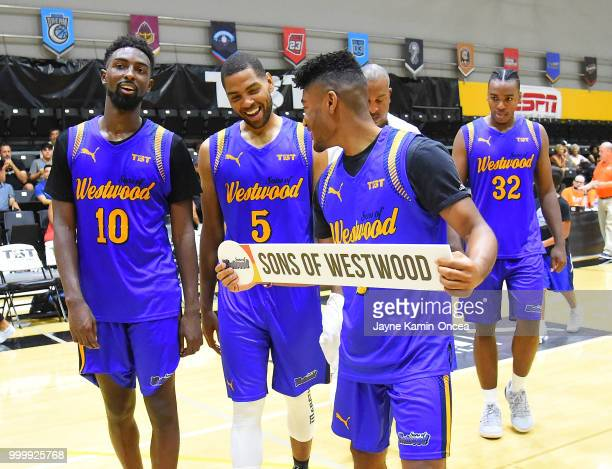 Isaac Hamilton and Khalif Wyatt walk with Jerrold Smith of the Sons of Westwood to pin their name on the winners bracket board after defeating the...