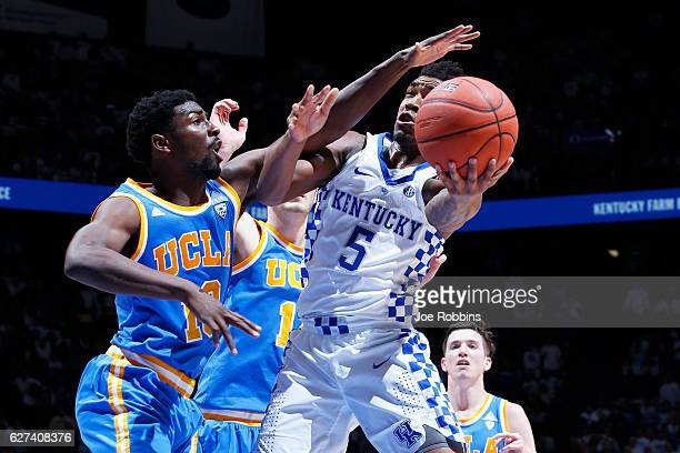 Isaac Hamilton of the UCLA Bruins defends against Malik Monk of the Kentucky Wildcats in the second half of the game at Rupp Arena on December 3 2016...
