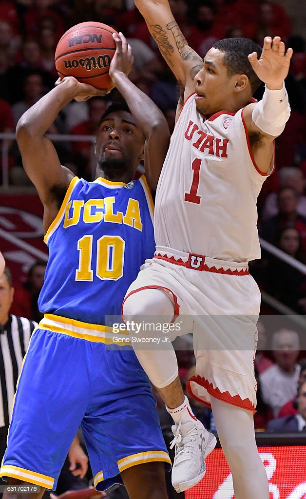 Isaac Hamilton #10 of the UCLA Bruins shoots past the defense of JoJo Zamora #1 of the Utah Utes in the second half of the Bruins 83-82 win at the Jon M. Huntsman Center on January 14, 2017 in Salt Lake City, Utah.