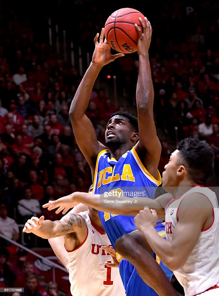 Isaac Hamilton #10 of the UCLA Bruins tries for the basket between the defense of JoJo Zamora #1 and Sedrick Barefield #2 of the Utah Utes in the second half of the Bruins 83-82 win at the Jon M. Huntsman Center on January 14, 2017 in Salt Lake City, Utah.
