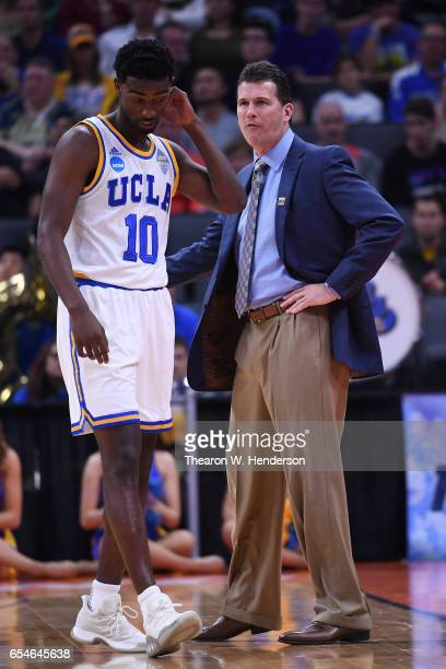 Isaac Hamilton speaks with Head coach Steve Alford of the UCLA Bruins against the Kent State Golden Flashes during the first round of the 2017 NCAA...
