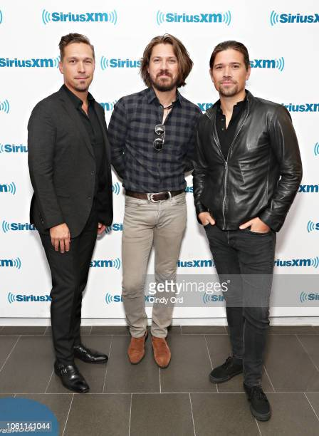 Isaac Hanson Taylor Hanson and Zac Hanson of Hanson visit the SiriusXM Studios on November 13 2018 in New York City