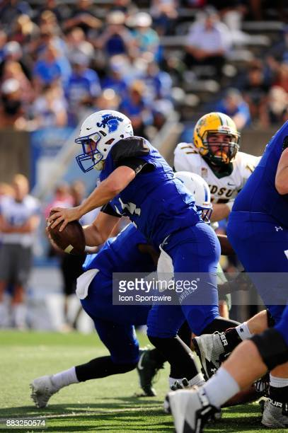 Isaac Harker quarterback Indiana State University Sycamores scrambles against the North Dakota State University Bison in a Missouri Valley Conference...