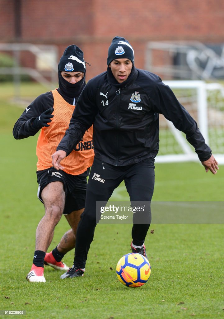 Isaac Hayden (R) controls the ball whilst DeAndre Yedlin (L) chases him during the Newcastle United Training session at The Newcastle United Training Centre on February 14, 2018, in Newcastle upon Tyne, England.