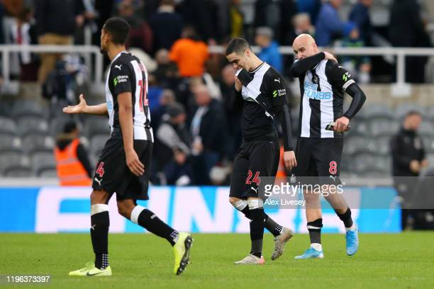Isaac Hayden, Miguel Almiron and Jonjo Shelvey of Newcastle United look dejected following their sides defeat in the Premier League match between...