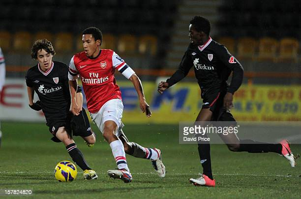 Isaac Hayden of Arsenal cuts inside Unai Lopez and Inaki Williams of Bilbao during the NextGen Series match between Arsenal and Athletico Bilbao at...