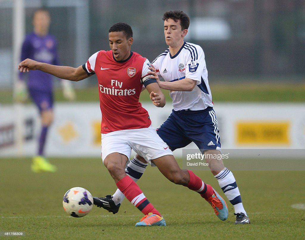 Isaac Hayden of Arsenal holds off Zach Clough of Bolton during the match between Bolton Wanderers U21 and Arsenal U21 in the Barclays Premier U21 League on March 31, 2014 in Lancaster, England.