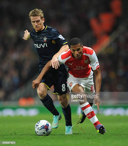 Isaac Hayden of Arsenal under pressure from Steven Davis of Southampton during the Capital One Cup 3rd match between Arsenal and Southampton at...