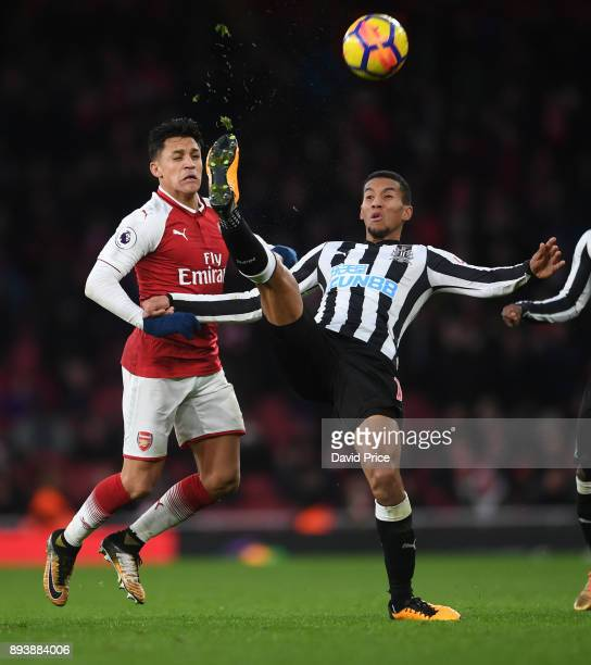 Isaac Hayden of Newcastle clears the ball from Alexis Sanchez of Arsenal during the Premier League match between Arsenal and Newcastle United at...