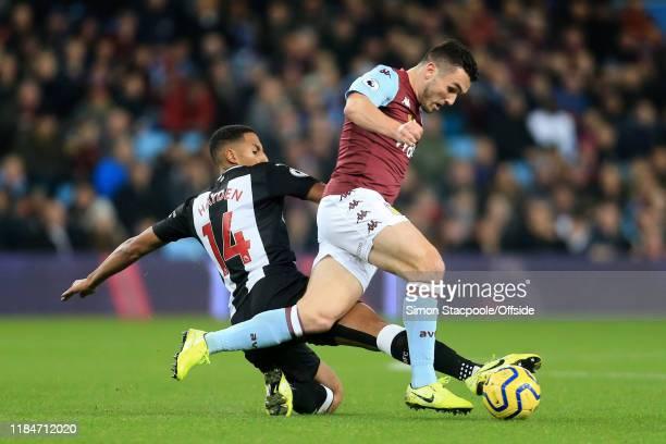 Isaac Hayden of Newcastle tackles John McGinn of Villa during the Premier League match between Aston Villa and Newcastle United at Villa Park on...