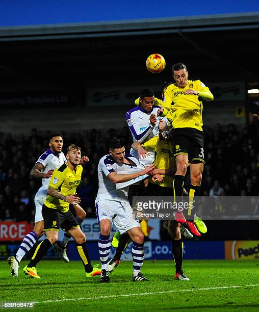 Isaac Hayden of Newcastle United and Ciaran Clark jostle with Jackson Irvine of Burton Albion and John Mousinho to win a header in the box during the...