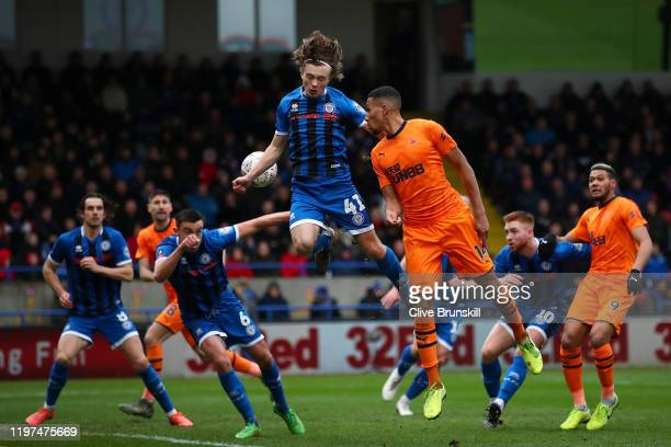Isaac Hayden of Newcastle United and Luke Matheson of Rochdale battle for a header during the FA Cup Third Round match between Rochdale AFC and...