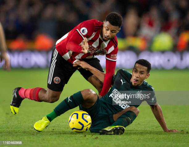 Isaac Hayden of Newcastle United and Lys Mousset of Sheffield United in action during the Premier League match between Sheffield United and Newcastle...