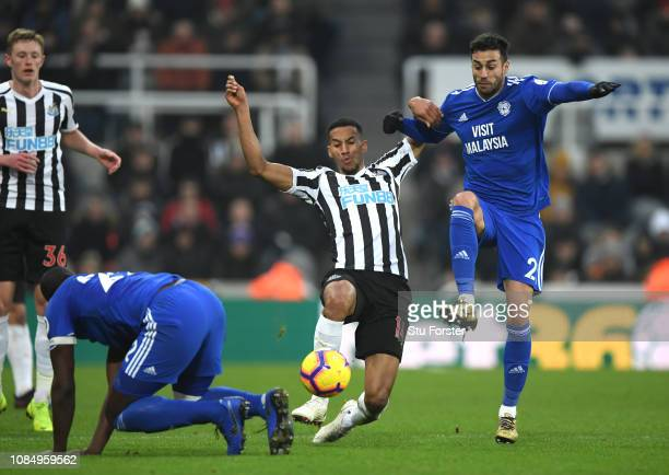 Isaac Hayden of Newcastle United battles for possession with Victor Camarasa of Cardiff City during the Premier League match between Newcastle United...