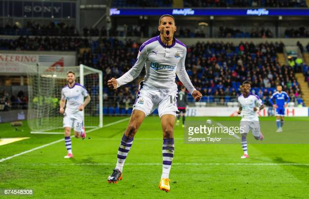 Isaac Hayden of Newcastle United celebrates after he scores Newcastle's second goal during the Sky Bet Championship match between Cardiff City and...