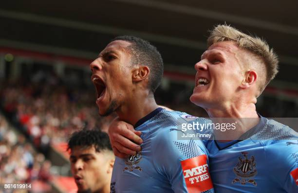 Isaac Hayden of Newcastle United celebrates as he scores their first goal with team mate Matt Ritchie during the Premier League match between...