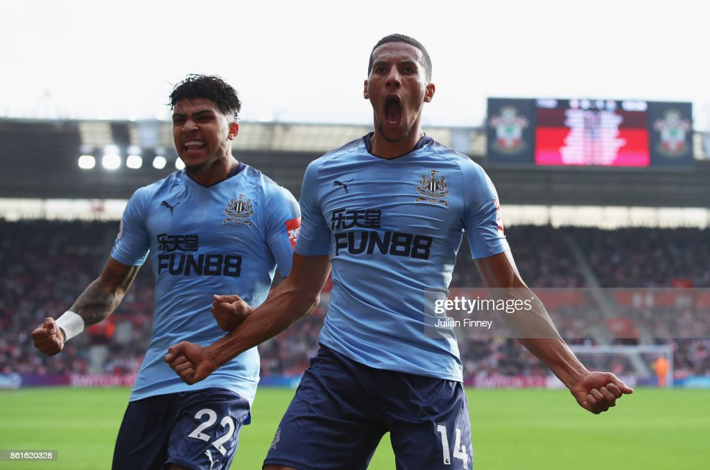 Isaac Hayden of Newcastle United (14) celebrates as he scores their first goal with team mate Deandre Yedlin during the Premier League match between Southampton and Newcastle United at St Mary's Stadium on October 15, 2017 in Southampton, England.