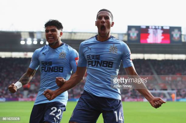 Isaac Hayden of Newcastle United celebrates as he scores their first goal with team mate Deandre Yedlin during the Premier League match between...