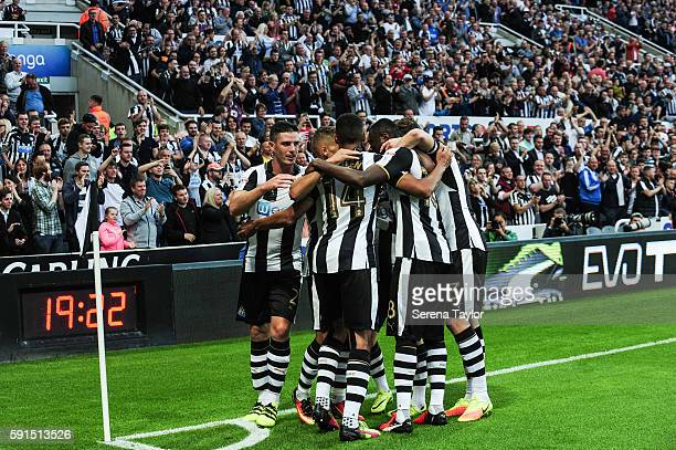 Isaac Hayden of Newcastle United celebrates with teammates after scoring the opening goal during the Sky Bet Championship match between Newcastle...