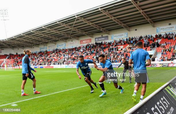 Isaac Hayden of Newcastle United FC and Jacob Murphy race in the warm up during the Pre Season Friendly between Doncaster Rovers and Newcastle United...