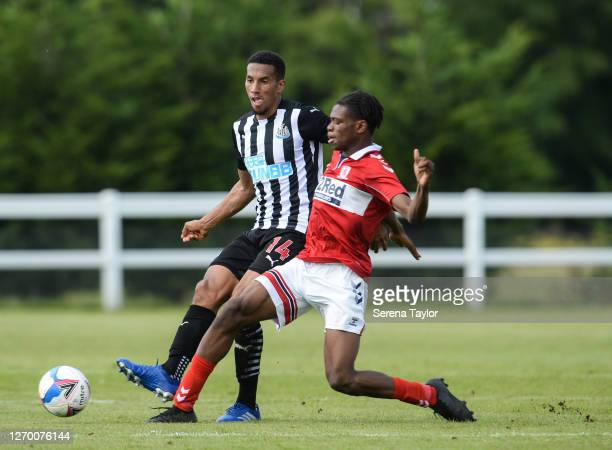 Isaac Hayden of Newcastle United FC crosses the ball as Sam Folarin of Middlesbrough FC during the Pre Season Friendly between Newcastle United and...