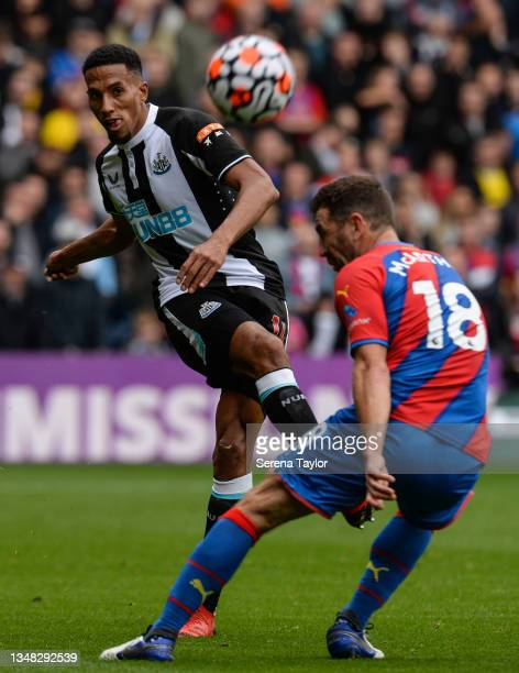 Isaac Hayden of Newcastle United FC has the ball deflected by James McArthur of Crystal Palace during the Premier League match between Crystal Palace...