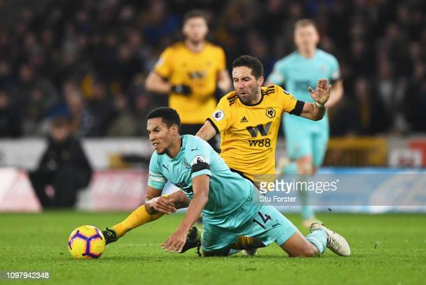 Isaac Hayden of Newcastle United is challenged by Joao Moutinho of Wolverhampton Wanderers during the Premier League match between Wolverhampton...