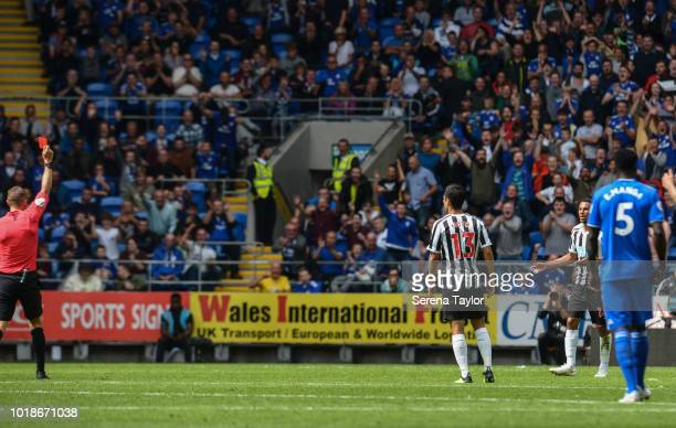 Isaac Hayden of Newcastle United is shown a red card from Referee Craig Pawson during the Premier League Match between Cardiff City and Newcastle...