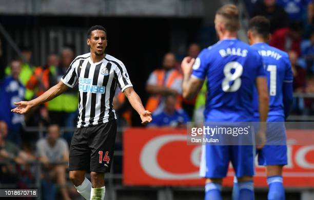 Isaac Hayden of Newcastle United reacts after being shown a red card during the Premier League match between Cardiff City and Newcastle United at...