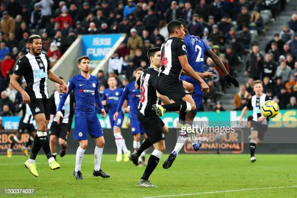 Isaac Hayden of Newcastle United scores the opening goal during the Premier League match between Newcastle United and Chelsea FC at St. James Park on...