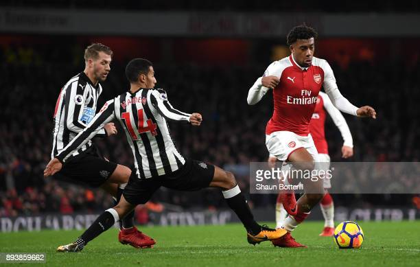 Isaac Hayden of Newcastle United tackles Alex Iwobi of Arsenal during the Premier League match between Arsenal and Newcastle United at Emirates...