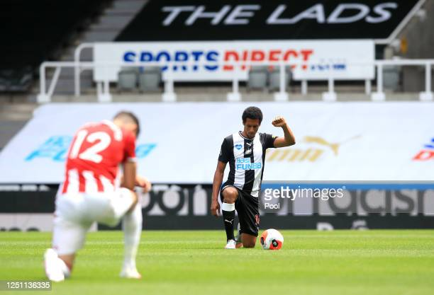 Isaac Hayden of Newcastle United takes a knee in support of the Black Lives Matter movement during the Premier League match between Newcastle United...