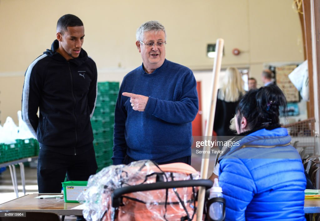 Isaac Hayden of Newcastle United talks with Foodbank CEO Mike Nixon during a visit to Newcastle West End Foodbank on September 14, 2017, in Newcastle upon Tyne, England.