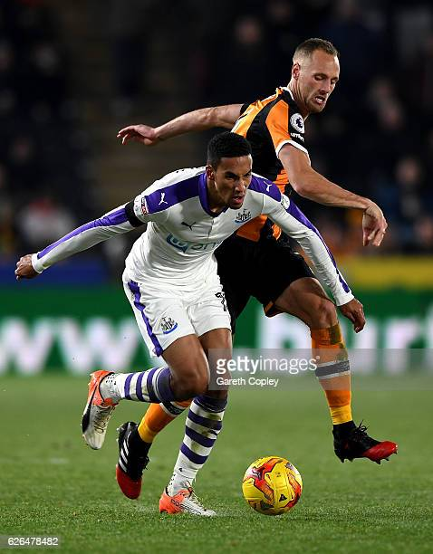 Isaac Hayden of Newcastle United tussles with David Meyler of Hull City during the EFL Cup QuarterFinal match between Hull City and Newcastle United...