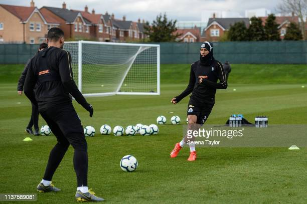 Isaac Hayden passes the ball during the Newcastle United Training Session at the Newcastle United Training Centre on March 22 2019 in Newcastle upon...