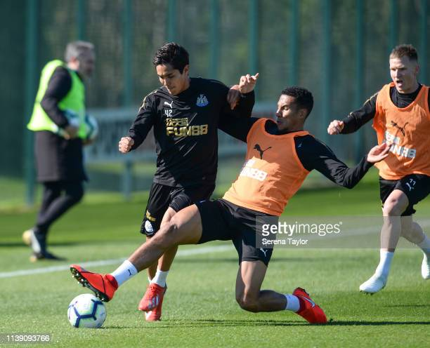 Isaac Hayden tackles Yoshinori Muto during the Newcastle United Training session at the Newcastle United Training Centre on March 29 2019 in...