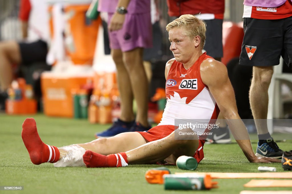 Isaac Heaney of the Swans sits on the sideline during the JLT Community Series AFL match between the Sydney Swans and the Greater Western Sydney Giants at Blacktown International Sportspark on March 9, 2018 in Sydney, Australia.