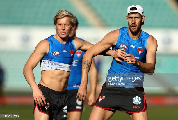 Isaac Heeney and Sam Naismith of the Swans train during a Sydney Swans AFL training session at Sydney Cricket Ground on July 11 2017 in Sydney...