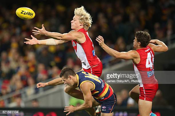 Isaac Heeney of the Swans flies over Luke Brown of the Crows during the 2016 AFL Round 04 match between the Adelaide Crows and the Sydney Swans at...
