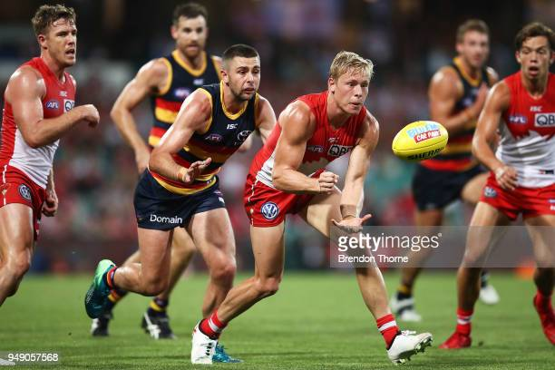 Isaac Heeney of the Swans handpasses during the round five AFL match between the Sydney Swans and the Adelaide Crows at Sydney Cricket Ground on...