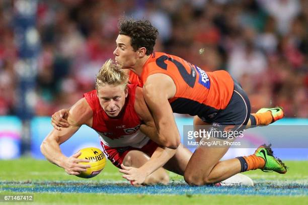 Isaac Heeney of the Swans is tackled by Josh Kelly of the Giants during the round five AFL match between the Sydney Swans and the Greater Western...