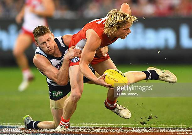 Isaac Heeney of the Swans is tackled by Mark Blicavs of the Cats during the AFL Second Preliminary Final match between the Geelong Cats and the...