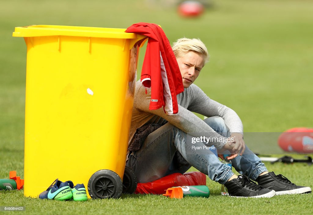 Isaac Heeney of the Swans looks from the sidelines during a Sydney Swans AFL training session at Lakeside Oval on March 8, 2017 in Sydney, Australia.