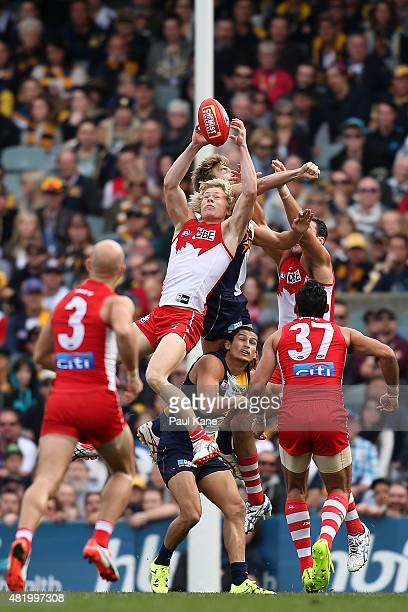 Isaac Heeney of the Swans marks the ball during the round 17 AFL match between the West Coast Eagles and the Sydney Swans at Domain Stadium on July...