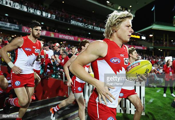 Isaac Heeney of the Swans runs out onto the field during the First AFL Semi Final match between the Sydney Swans and the Adelaide Crows at the Sydney...