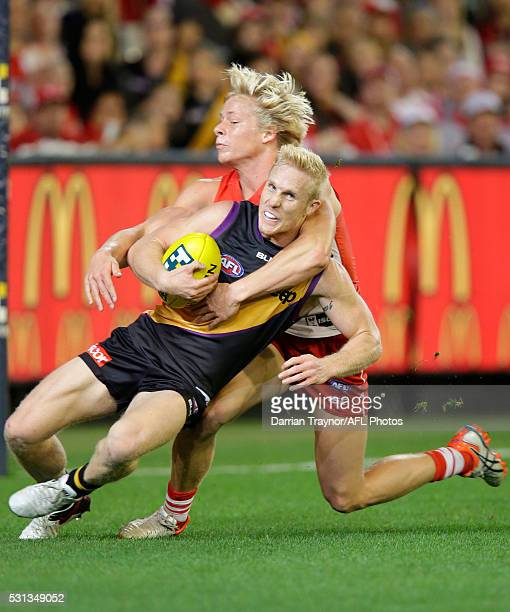 Isaac Heeney of the Swans tackles Steven Morris of the Tigers high during the round eight AFL match between the Richmond Tigers and the Sydney Swans...